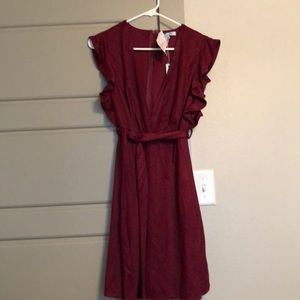 Burgundy deep v dress with ruffle around sleeve